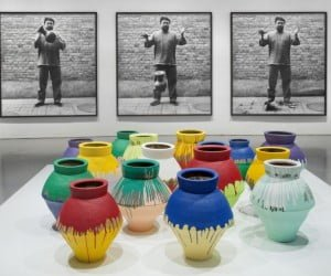 former fn: Ai-Weiwei-installation-11 Ai Weiwei: According to What? From top to bottom: Dropping a Han Dynasty Urn, 1995/2009; Colored Vases, 2007-2010. Installation view of Ai Weiwei: According to What? at the Hirshhorn Museum and Sculpture Garden, Washington D.C., 2012. Photo: Cathy Carver.